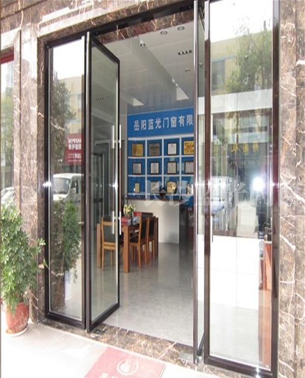 长沙蓝光平开地弹门(电黑木纹)       长沙蓝光品牌门窗厂