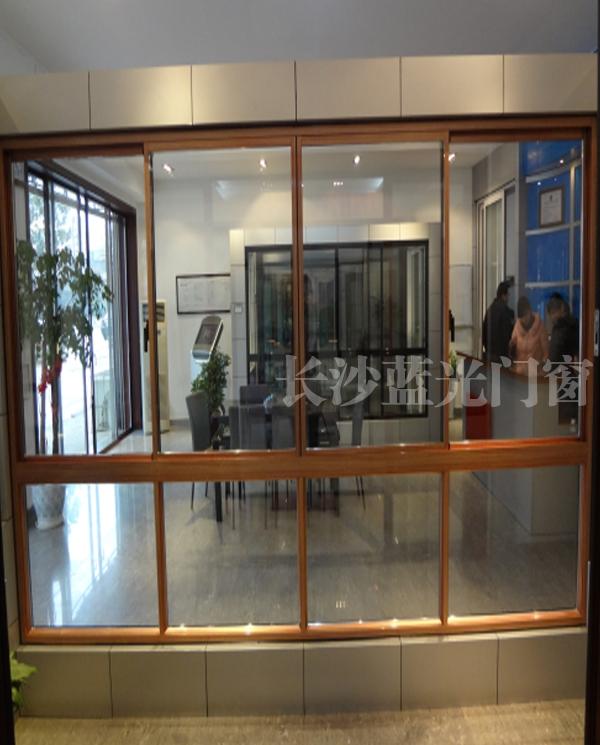 长沙蓝光新款隔热断桥(钛金电木纹+红铜)      长沙蓝光品牌门窗厂